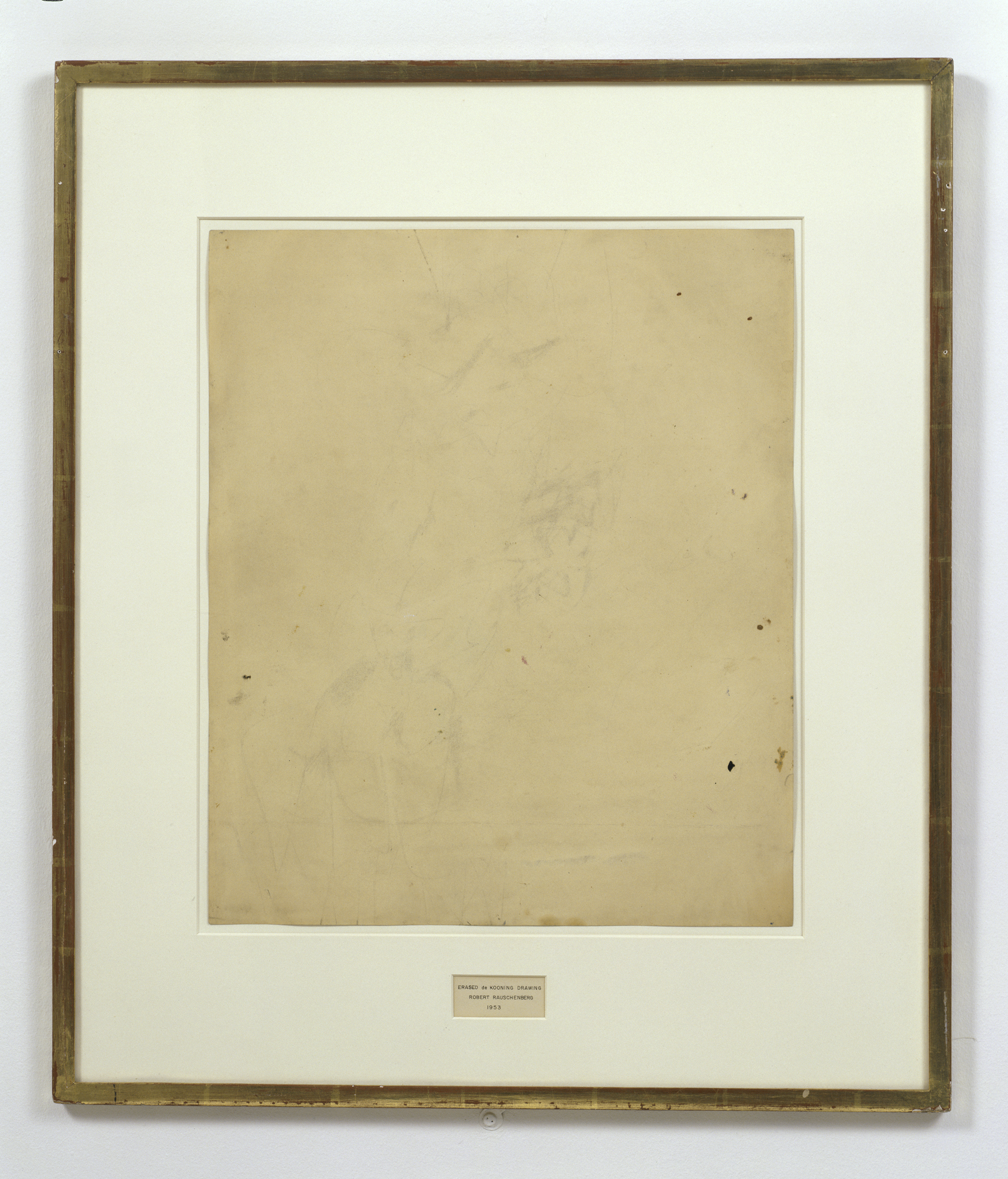Robert Rauschenberg, Erased de Kooning (1953). Traces of drawing media on paper with label and gilded frame [64 x 55 x 1 cm]. San Francisco Museum of Modern Art, San Francisco